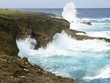 Waves splashing against the cliffs Mesmerizing view of giant waves at As Matmos Fishing Cliff, Rota, Northern Mariana Islands