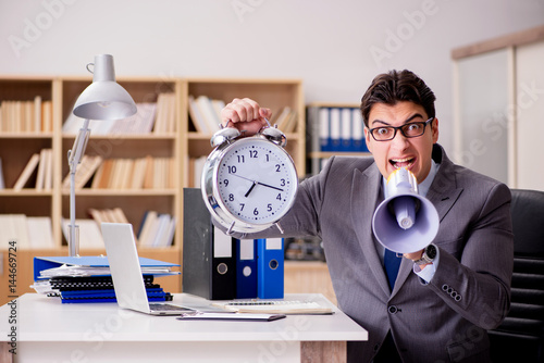 Businessman with loudspeaker megaphone in office - 144669724