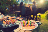 Dinner party, barbecue and roast pork at night - 144684158