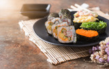 Mix sushi on old brown rust background.