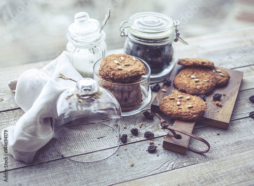 Poster Oatmeal cookies in glass jars on wooden table