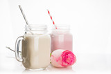 Strawberry and banana milkshakes on the white background