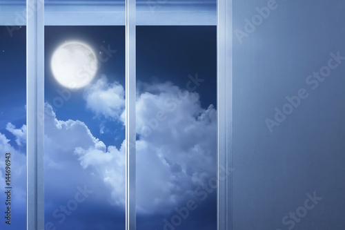 Window glass in the empty room with moonlight