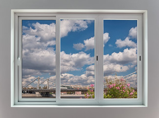 View of the Moscow city landscape through a triple window with sliding frames