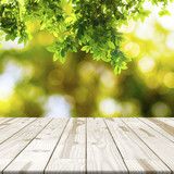 Wood table top on Green leaf with nature blurred in background - 144726980