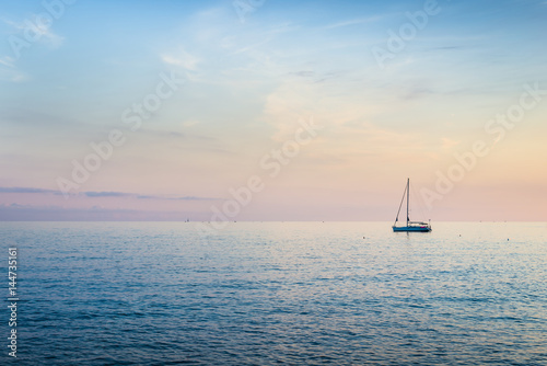 Rich evening color palette of sunset. Mediterranean Sea. Italy. Poster