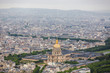 View of the streets of Paris from the heights. Travel through Europe. Attractions in France. Cloudy Paris. Clouds in the sky. Beautiful view at the Pont Alexandre III and Les Invalides in Paris