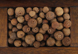 allspice in wooden box isolated - 144767996