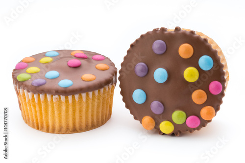 Multiple colorful decorated muffins on a white background. Poster