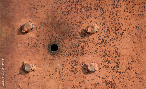 abstract background with hole and screws, and texture rust orange-brown with spots