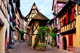 Fototapety Colorful timbered houses of the Alsatian town of Eguisheim, France