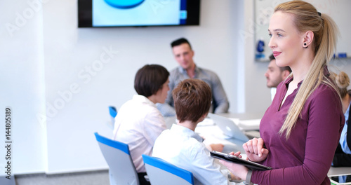Pretty Businesswoman Using Tablet In Office Building during conference