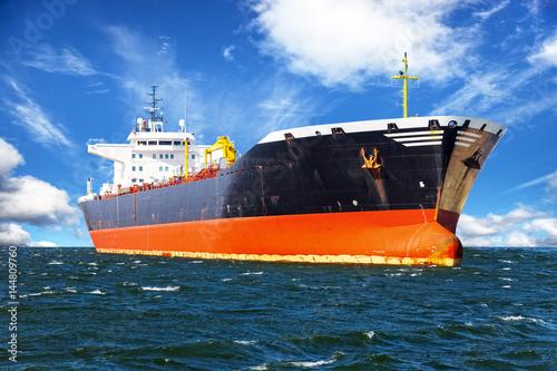 Fototapeta Oil tanker ship at sea on a background of blue sky.