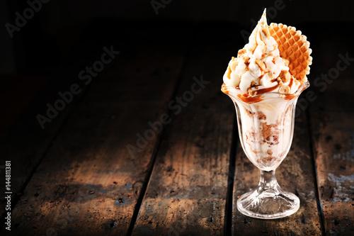 Delicious ice cream sundae with flake