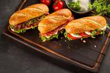 Three gourmet fast food sandwiches