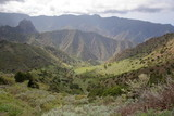 LA GOMERA, SPAIN: Mountainous and green landscape with terraced fields between Agulo and Vallehermoso