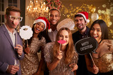 Group Of Friends Dressing Up For Christmas Party Together - 144839552