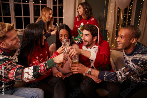 Poster Friends In Festive Jumpers Celebrate At Christmas Party