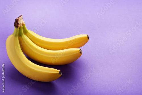 Sweet bananas on the purple background