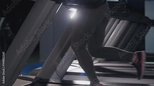 Tuinposter Gymnastiek Fit women running on treadmills in the gym