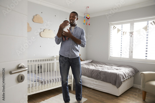 Poster Father Holding Newborn Baby Son In Nursery