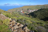 ARURE, LA GOMERA, SPAIN: Green landscape with Arure and the Atlantic Ocean in the background