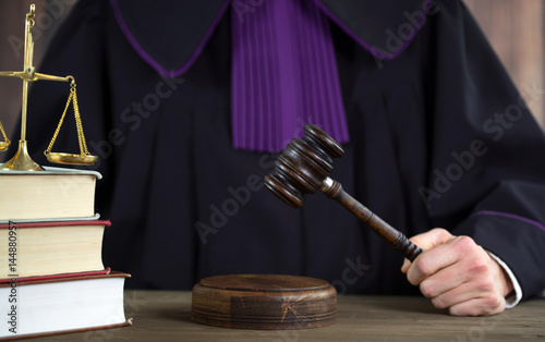 Judge in courtroom. Mallet and Scale