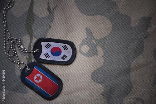 Plexiglas Seoel army blank, dog tag with flag of south korea and north korea on the khaki texture background. military concept