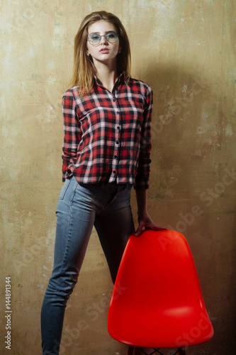 Poster Pretty girl in glasses wearing red plaid shirt and jeans