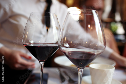 Serving a glass of red wine in a restaurant
