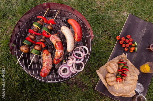 Grill with various delicious barbecue outdoor, top view