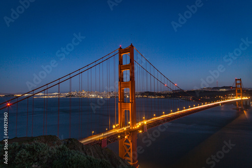 Poster Aerial view of the Golden Gate bridge in San Fransisco during golden hour and tr