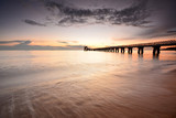 Long exposure shot of seascape with long jetty background.