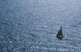 Sailboat from air in vast ocean