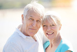 Portrait of happy senior couple in fitness outfit