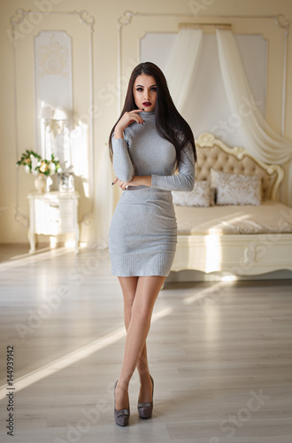 Plakat Beautiful girl in a sexy white dress