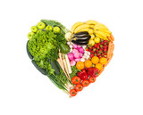 Heart made out of fruits and vegetables isolated on white background  - 144940787