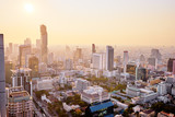 Sunset in megapolis. Beautiful cityscape with top view on skyscrapers. Bangkok, Thailand.