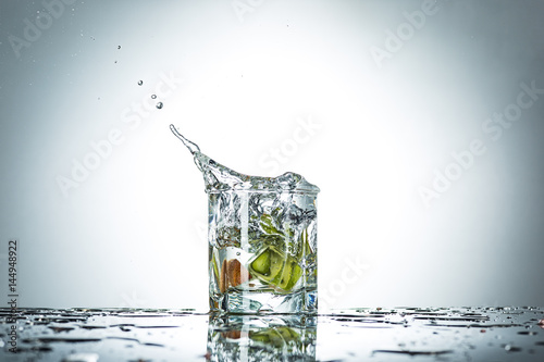water splash in glass of gray color - 144948922