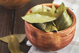 Dry bay leaves (Laurus nobilis) in wooden bowl - 144954748