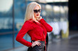 Woman in the red shirt and sunglasses