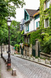 Charming old street of Montmartre hill. Paris, France