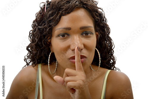 Juliste beautiful african woman with finger on her lips