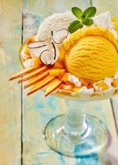 Peach and Vanilla Ice Cream Sundae with Fruit