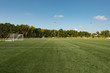 Soccer field background with a shallow depth of field on a beautiful summer day