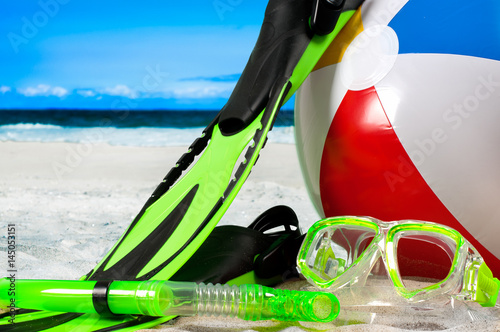 Mask goggles with snorkel and flippers on the beach Poster