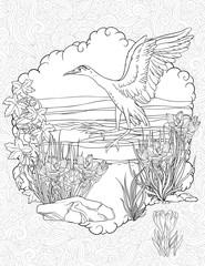 Bird landing in a grass on a river