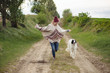 Young woman run with dog outdoor