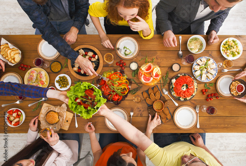 People eat healthy meals at served table dinner party - 145069541