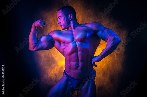 An athlete with big muscles Poster